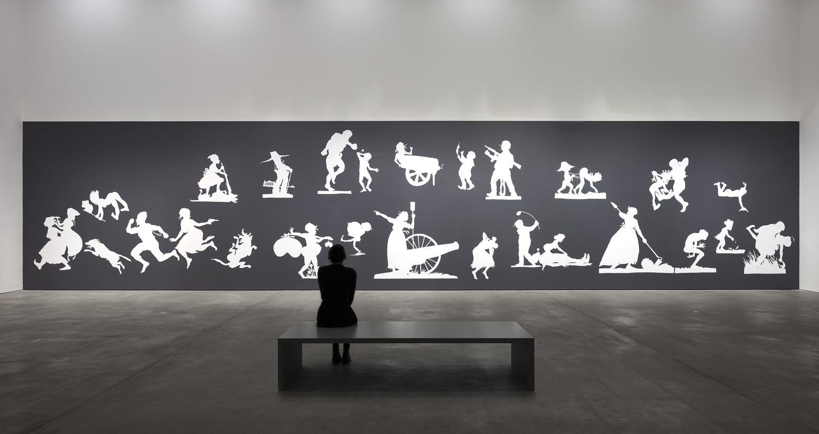 Image: Installation View, Kara Walker, THE SOVEREIGN CITIZENS SESQUICENTENNIAL CIVIL WAR CELEBRATION, 2013, Cut paper and adhesive on wall, approximately 470 x 2000 cm, 185 1/8 x 787 3/8 inches, Sprüth Magers, Berlin, 2020 Photography Timo Ohler Courtesy Sprüth Magers and Sikkema Jenkins & Co.