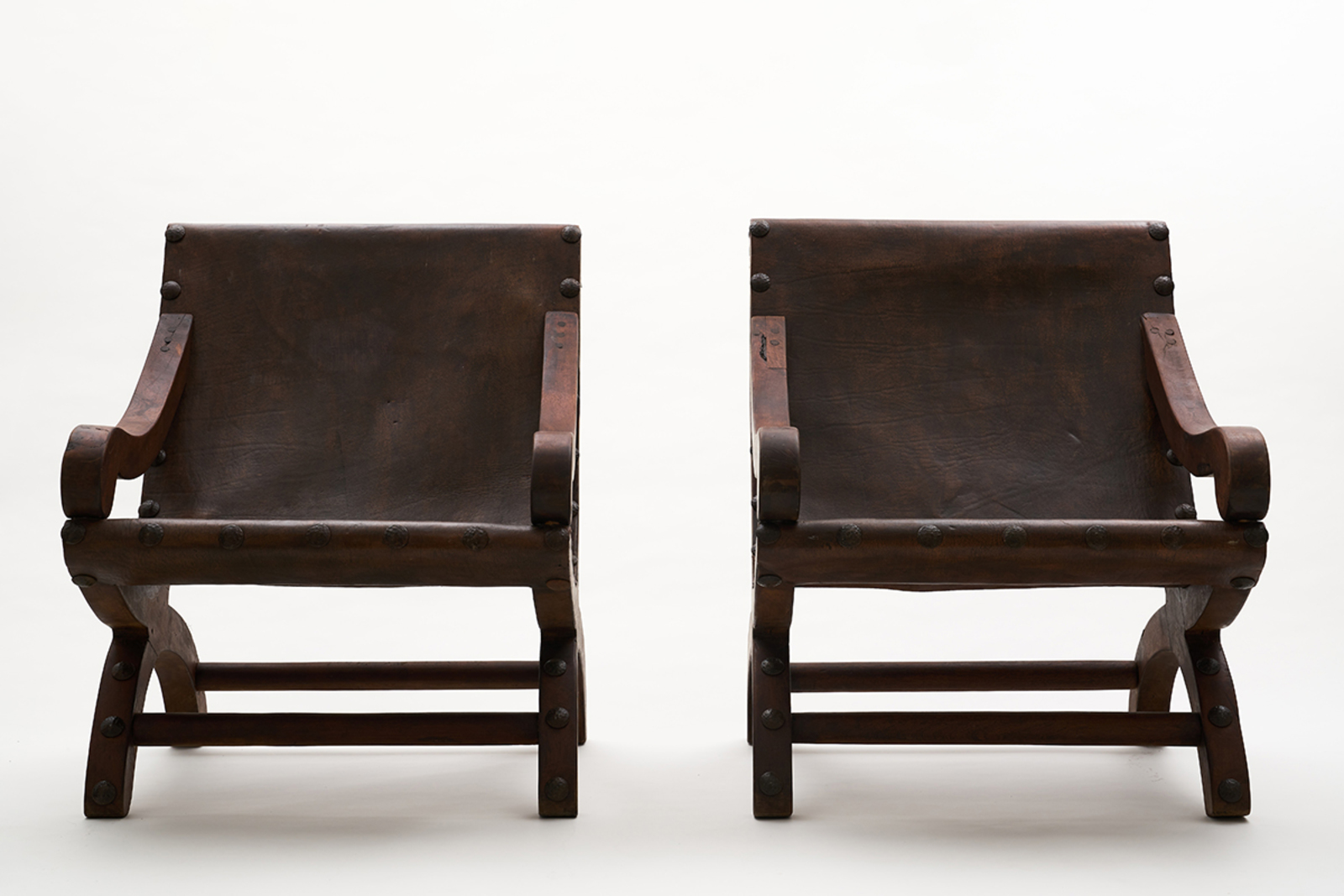 Miguelito chairs, 1960, wood, leather, iron nails, 80 x 72 x 90 cm each.  Courtesy of SHOP Taka Ishii Gallery, Hong Kong / Photo: Anthony Kar-Long Fan