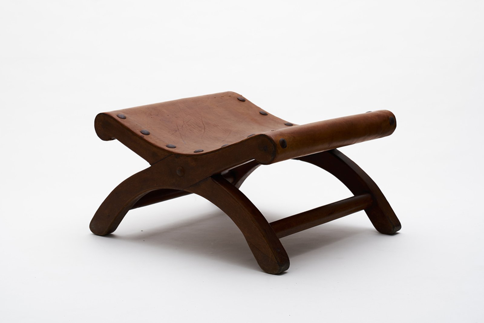 Ottoman, 1960, cedar wood, cowhide leather, iron nails, 58 x 68 x 38 cm. Courtesy of SHOP Taka Ishii Gallery, Hong Kong / Photo: Anthony Kar-Long Fan